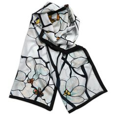 This elegant scarf features a detail adapted from the Magnolia window for the Tiffany mansion at 72nd Street and Madison Avenue in New York.