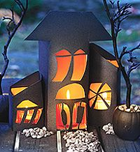 Follow these step-by-step instructions to create a charming haunted house from empty juice cartons