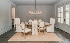 French dining room features gray walls accented with gray trim moldings surrounding a Restoration Hardware Salvaged Wood Trestle… Oak Dining Room Chairs, Dark Wood Dining Table, Woven Dining Chairs, Round Back Dining Chairs, Mismatched Dining Chairs, Vintage Dining Chairs, Dining Chair Slipcovers, Dining Nook, Accent Chairs For Living Room