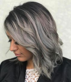 Dark silver grey hair color with a shadow root and a hint of lilac by Aveda Artist Angelina.