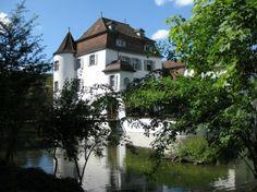moated castle switzerland water
