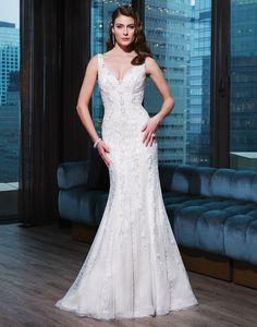Justin Alexander signature wedding dresses style 9772 Tulle, hand beading fit and flare dress accented with a V-neck.