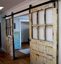 Salvaged vintage DIY sliding barn door glass windows