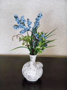 Seashell Vase with an Artificial Floral by JPsCraftyCreature