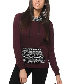 Improve your outfits with a stylish blackberry colorway accented by a black and white tribal print hood and kangaroo pouch pocket plus a fleece lining to keep you comfortable.