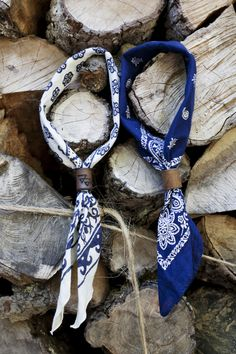 """The clasps are called """"Woggles"""". If you'd rather not tie a knot, this is a great option to avoid the Cowboy look. Many variations on this: leather, wood, and metal. To avoid the pricey designer ones, hit the plumbing / electrical sections of the local hardware store for cheapie solution."""