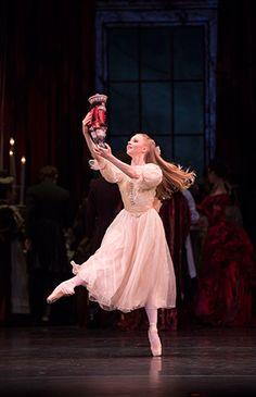 Karla Doorbar as Clara with her nutcracker in Birmingham Royal Ballet's Nutcracker; photo: Bill Cooper
