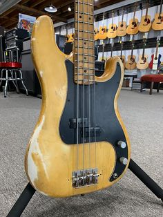 Heavy relic'd 1978 Fender Precision Bass. There were a lot of stickers on the back and when removed, also removed some of nicotine and a small bit of the finish. This guy plays great and sounds fantastic! If you don't mind a player this one is for you. Dimarzio pickups. Replaced pickguard. No... Fender P Bass, Fender Precision Bass, Fender Electric Guitar, Bass Guitars, Bass Guitar Lessons, Custom Guitars, Playing Guitar, Musical Instruments, Stickers