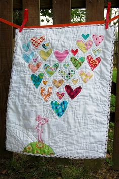 Great idea for re-using old baby clothes! The hearts are made out of her old…