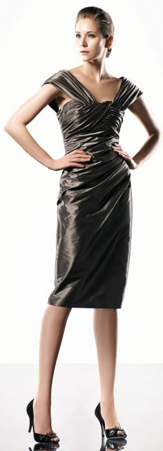 V-neck straps knee-length dress.  So hard to find knee length cocktail dresses for tall women!!