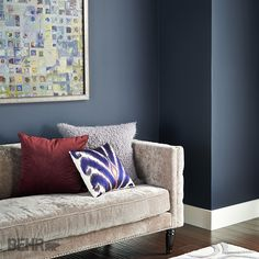 Deep Dreams: Dark colors will transform a #bedroom into a dreamy, mythical landscape. Layers of color and texture are found in the bedding, bringing bright pops of color for volume and interest. #2015ColorTrends #BehrPaint Featured Color: Seared Gray T15-2