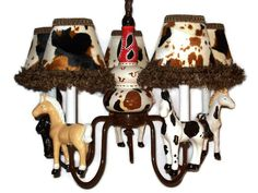 Hey, I found this really awesome Etsy listing at https://www.etsy.com/listing/31713665/western-horse-chandelier-cowboy-room