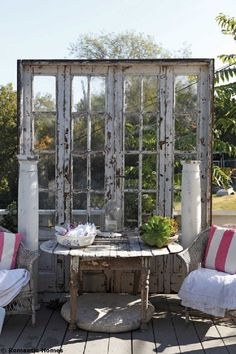 Absolutely LOVE this idea!!! At the end of my front porch..... Re  Purpose Old Door Into Desk Screen