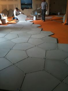 Custom GRFC tiles on Scluter-DITRA uncoupling Layer, waterproofing mambrane, and vapor management layer that accomodates moisture from beneath the covering