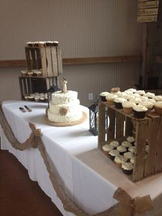 I like this idea too, small cake and wooden crates to display cupcakes