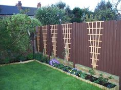 Trellis idea for Clematis..along back and maybe side fences. Mix colors or flowers.