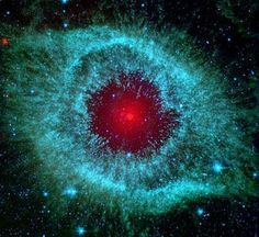 ~~Dust and the Helix Nebula ~ Dust makes this cosmic eye look red. The eerie Spitzer Space Telescope image shows infrared radiation from the well-studied Helix Nebula (NGC a mere 700 light-years away in the constellation Aquarius Helix Nebula, Planetary Nebula, Orion Nebula, Andromeda Galaxy, Eagle Nebula, Planetary System, Space Photos, Space Images, Constellations