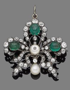 A late 19th century emerald, pearl and diamond brooch/pendant The clover leaf openwork plaque, set with oval cabochon emeralds and collet-set cushion-shaped diamonds, decorated with similarly-cut diamond ribbon details and a 6.00mm bouton pearl, suspending a 6.00mm pearl drop, mounted in silver and gold, diamonds approx. 2.85cts total, pearls untested, detachable brooch fitting, length 4.0cm