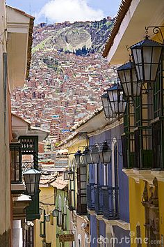 South America.  The city of La Paz, Bolivia, climbs the hills resulting in varying elevations from 3,000 meters to 4,100 meters (9,840 ft to 13,450 ft). Overlooking the city is towering triple-peaked Illimani, which is always snow-covered and can be seen from several spots of the city, and also from the neighboring city of El Alto