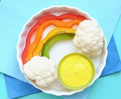 Cute Snack Idea: A Sweet and Healthy Veggie Rainbow...pretzel stix could be the land beneath the cauli clouds.