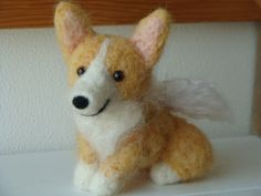 a plush corgi sure dumbs the subject down as a model for a whimsical dog painting! i like!