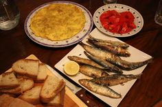 """Spanish food is the best No wonder all the doctor recommend a 'Mediterranean diet The Spanish Thyme Traveller SL originally shared:  Tortilla de patata, sardines , tomato salad and """"pan de pueblo""""(rustic/village bread) #classicfood  #Spain  #rural  #typical  #travel"""