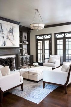 Living room with clean, crisp lines and rich-brown molding.