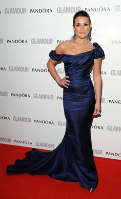 Lea Michele attended the 2012 Glamour Women of the Year Awards in London wearing this stunning, navy, off the shoulder, Zac Posen gown.    The Glee star accessorized her elegant look with aqua-and-sapphire Lorraine Schwartz gems and metallic heels.