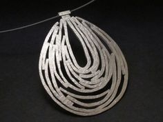 This Sterlng silver pendant hangs from a Niobium neck cable with a hook and eye clasp. It is a substantial piece honoring our fascination, our connection and reliance on water. Jewelry Tools, Wire Jewelry, Jewelery, Jewelry Making, Silver Pendants, Silver Necklaces, Silver Jewelry, Artisan Jewelry, Handmade Jewelry