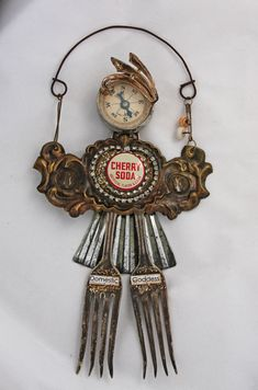 Assemblage Art Doll, junk art, found object; recycled, salvaged metal; Upcycle, Recycle, Salvage, diy, thrift, flea, repurpose! For vintage ideas and goods shop at Estate ReSale & ReDesign, Bonita Springs, FL