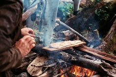 Dan Malloy cooking fish in Great Bear Rainforest.  Photo by Trevor Gordon