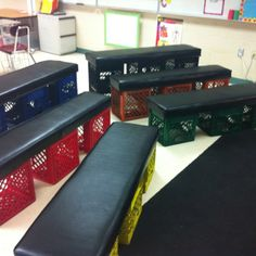 Classroom benches- three different levels so everyone can see- the top level is a milk crate + a half one zip tied together- middle is a crate on the side and the bottom is a crate flat on the ground- 3 crates for each bench- I love them!