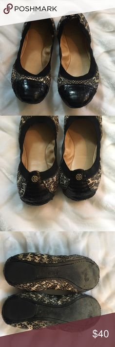 Tory Burch snakeskin flats ✔️READ description✔️ Very well worn authentic Tory Burch snakeskin flats. There are no through and through holes but there is a lot of wear. The wear is on the underside of the upper so when worn it's not noticeable but as you can see from the pics, it's there. Please look at the pictures, expand and ask questions. These still have life left and are a great deal if you want a pair or Tory flats. Tory Burch Shoes Flats & Loafers