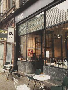Rounded marble exterior, pendant lights, windows  thegiftsoflife:  Coffee & Vinyl, Antwerp