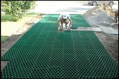Bill James laying permaturf for grass driveway. Drought-tolerant grass driveway.