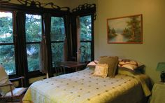 Bellaterra B&B, a Victorian with ample common spaces, reading nook, traditional moldings and custom carvings, and five nature- and culture-themed guest rooms, each furnished with antiques and having its own glass or stone-tiled bathroom.