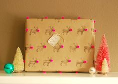 A stamp and pom poms create this unique DIY wrapping paper. #HoliDIY http://www.ivillage.com/diy-wrapping-paper/7-a-551596