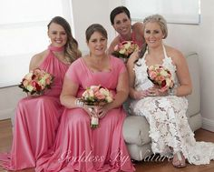 Stunning boho bride Kylie with her gorgeous bridal party in their Goddess By Nature signature multiway ballgowns in the amazing coral kiss colour with pretty bouquets