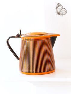 Vintage French Enamel Milk - Hot Water Jug - Art Deco 1920s - BB Frères Orange - Free Shipping within the USA by ScrumptiousVenus on Etsy https://www.etsy.com/listing/277357186/vintage-french-enamel-milk-hot-water-jug