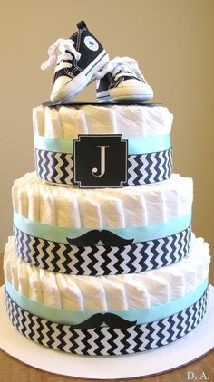 Converse, Chevron and Mustache Diaper Cake.That is cute. Please check out my website Thanks. http://www.photopix.co.nz