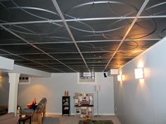 Low cost, low maintenance, easy-to-install, decorative ceiling tiles and suspended ceiling panels for both drop ceilings and glue-up installations. Drop Ceiling Tiles, Dropped Ceiling, White Ceiling, Ceiling Lights, Ceiling Installation, Space Place, Indoor Air Quality, Modern Contemporary, Basement