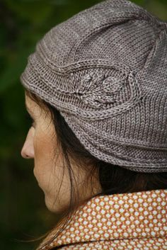 Oak Trail.  A cloche-style hat that sits low and frames the face with a stunning embossed oak leaf gracing one side.