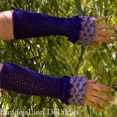 Dragon Scale Fingerless Gloves with extended sleeves.  This style is $25 plus…