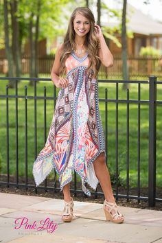 We adore the vibrant color combination and patterns on this dress! It combines a rainbow of colors with floral and geometric patterns to create a knockout dress! To top it off, it has a peach bodice with a floral white pattern.