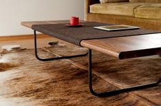 I like the midcentury curves in this coffee table. 56″L x 22″W x 12.5″H, solid walnut top
