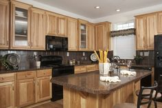 A great Hickory Kitchen shown in The Austin II AW237A - Aurora Classic Ranch Modular Home