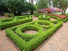 Formal Garden Designs and Ideas Have you ever really thought about how many people see the outside of your home? Boxwood Garden, Garden Hedges, Gravel Garden, Garden Paths, Boxwood Topiary, Topiaries, Formal Garden Design, Herb Garden Design, Garden Ideas