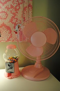 Spray paint a cheep plastic fan to match the room. Looks so much better then the cheap white plastic!