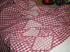 Hand+smocking+on+gingham+is+a+fun+way+to+bring+a+little+texture+to+fabric+creations!+Here+is+an+apron+that+was+made+out+of+fabric+that+was+'smocked'+by+counterchange+method! Counterchange+is...