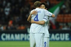 Atsuto Uchida Photos - Atsuto Uchida (R) and Benedikt Howedes of Schalke 04 celebrate victory at the end of the UEFA Champions League Quarter Final match between FC Internazionale Milano and Schalke 04 at San Siro Stadium on April 5, 2011 in Milan, Italy. - Inter Milan v Schalke 04 - UEFA Champions League Quarter Final